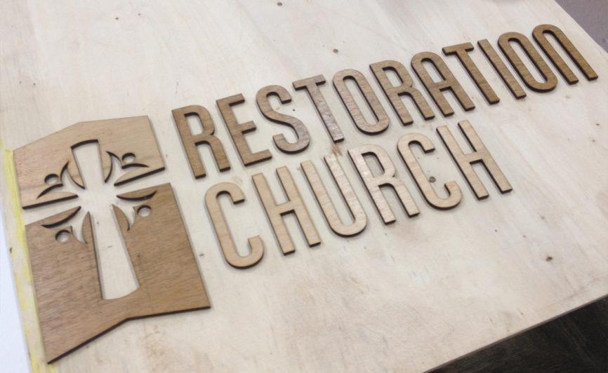 Restoration Church Wood Sign Design by Typework Studio Design Agency